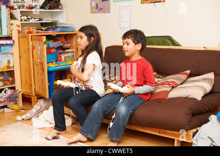 Children playing video games together - Stock Photo