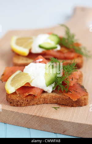 Canapes with smoked salmon and salad - Stock Photo