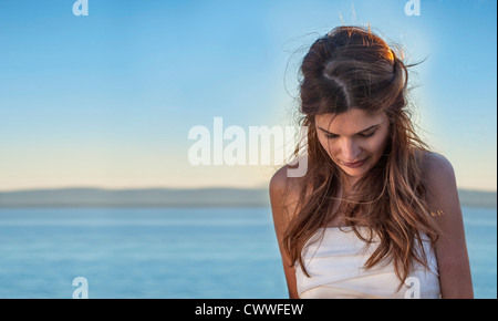 Woman standing on beach - Stock Photo