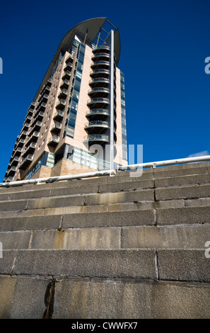 An apartment block at Salford Quays in Manchester, England, UK, with a set of concrete steps in the foreground - Stock Photo