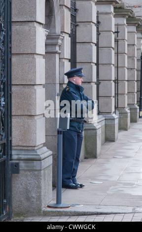 A garda on duty on Kildare Street in Dublin Ireland - Stock Photo