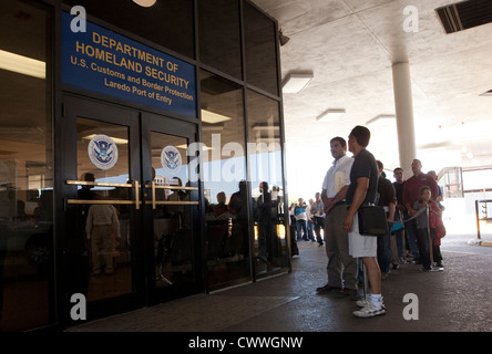 Group of mostly Mexican citizens wait in line to show documentation, to enter the US and the Texas, Mexico border - Stock Photo