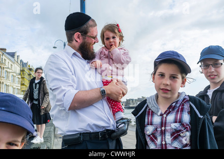 An ultra-Orthodox jewish family on summer holiday in Aberystwyth Wales UK August 13 2012 - Stock Photo