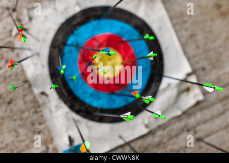 Archery - numerous arrows in a target - Stock Photo
