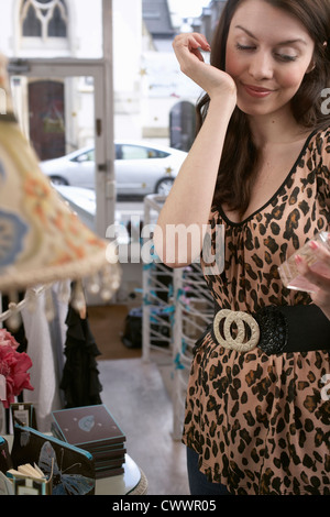 Woman trying on perfume in store - Stock Photo