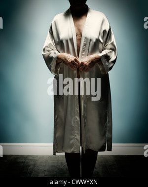 Older woman wearing open bathrobe - Stock Photo