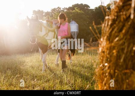 Woman riding her quarter horse in autumn, Poncha Pass, Rio
