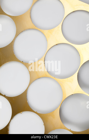 Brass sheet with round holes, brass scrap - Stock Photo