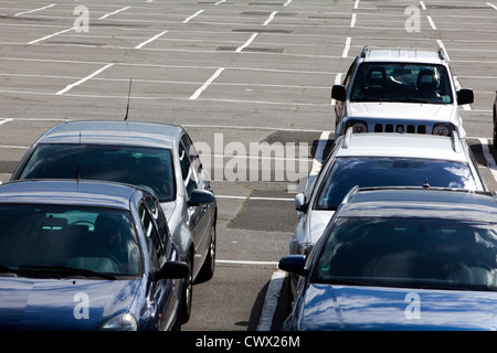 Occupied parking area, concept image, parking spaces in Germany, Europe - Stock Photo