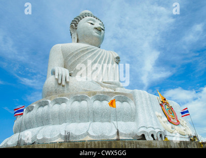 Massive white marble Buddha statue and tourist destination on top of hill in Phuket, Thailand. - Stock Photo