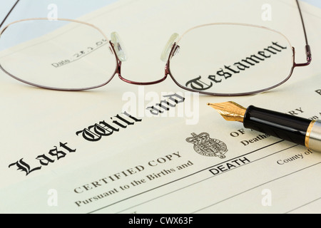 Last Will and Testament official document with a Death Certificate, a pair of metal rimmed reading glasses and a fountain pen for signing. England UK Stock Photo
