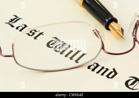 Last Will and Testament document with a pair of metal rimmed spectacles and a fountain pen for signing. England UK Britain Stock Photo