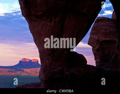 Monument Valley Tribal Park. Teardrop Arch looking north. Arizona/Utah Sunset. - Stock Photo