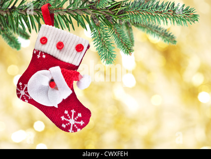 Christmas sock with Santa Claus on on fir branch. - Stock Photo