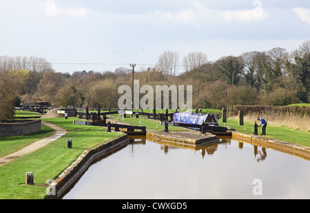 Opening the sluice gate at locks on the Trent and Mersey English canal at Rode Heath, Cheshire, England, UK - Stock Photo