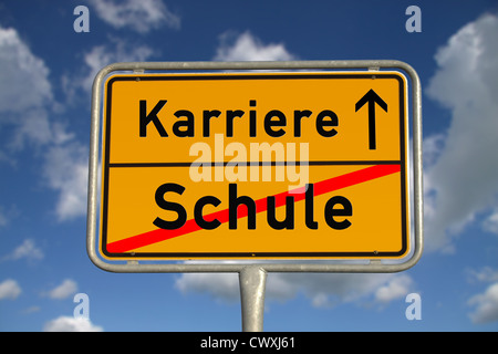German road sign school and career with blue sky and white clouds - Stock Photo