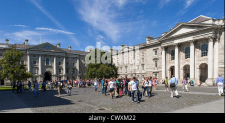 University students in the grounds of Trinity College Dublin, Ireland - Stock Photo