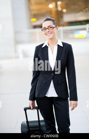 female jetsetter walking in airport - Stock Photo