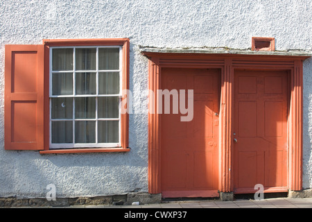 Terrace House with Terracotta colored Doors and Shutters - Stock Photo
