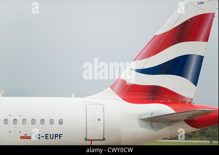 A close up of the British Airways logo on the tail fin of a passenger aircraft (Editorial use only) - Stock Photo
