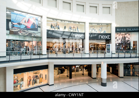 An indoor shot of the entrance / storefront of the Next flagship store in Manchester Arndale Centre. - Stock Photo