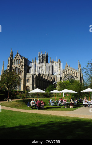 Moon over Ely Cathedral and The Almonry restaurant gardens, Ely, Cambridgeshire, England, UK - Stock Photo