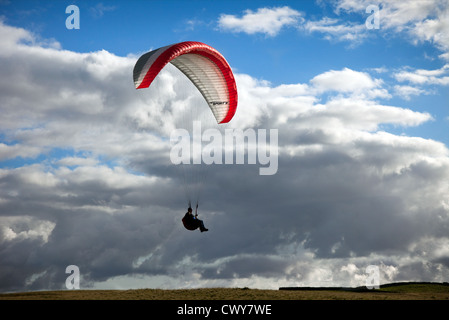 Paraglider with Sport 3 red and white wing on Dodd Fell near Hawes, Richmondshire, North Yorkshire Dales National - Stock Photo