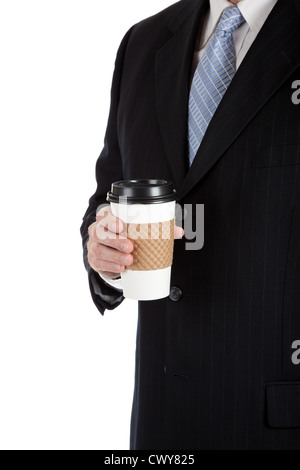 A man in a business suit holding a cup of coffee - Stock Photo
