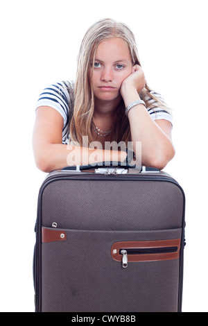 Bored young traveller tourist woman waiting with luggage, isolated on white background. - Stock Photo