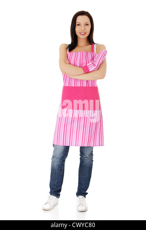 Young housewife in appron, isolated on white background - Stock Photo