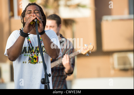 Las Palmas, Spain-September 8, 2012: Reggae band Riseland, from Canaries Islands, performing in a park in Las Palmas - Stock Photo