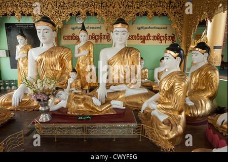 A collection of Buddha statues in a shrine, Shwedagon Paya (Shwedagon Pagoda), Yangon (Rangoon), Myanmar (Burma) - Stock Photo