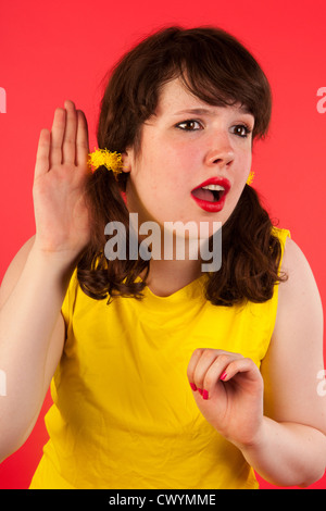 Young girl cannnot hearing what you say - Stock Photo