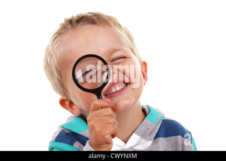 Boy searching with magnifying glass - Stock Photo