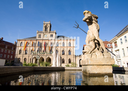 Neptune fountain and town hall on the market square in Weimar, Thuringia, Germany - Stock Photo