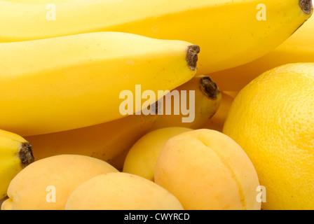 yellow background of fresh fruits - Stock Photo