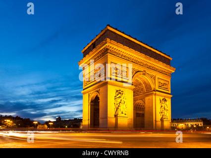 Traffic light trails around Napoleons Arc de Triomphe Place Charles de Gaulle Champs Elysees Paris France EU Europe