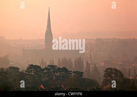 A view of Salisbury Cathedral early in the morning on a misty day, taken from Old Sarum - Stock Photo