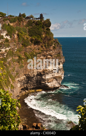 The Pura Luhur Uluwatu temple dramatically sighted on southern Bali's Bukit Peninsula, Bali, Indonesia. - Stock Photo