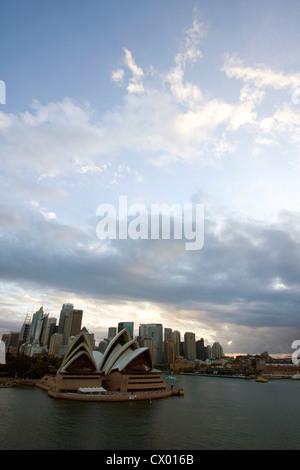 Sailing into Sydney past the Opera House at sunrise, Sydney, New South Wales, Australia - Stock Photo
