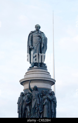 The statue by sculptor John Henry Foley of Daniel O'Connell on O'Connell Street in Dublin Ireland - Stock Photo