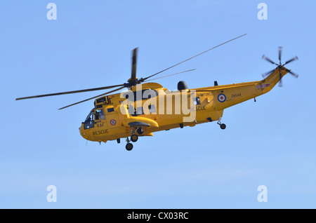 Westland Sea King HAR3 RAF Rescue helicopter in flight - Stock Photo