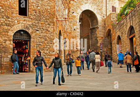 Typical street scene in walled town of San Gimignano, Siena, Tuscany, Italy - Stock Photo