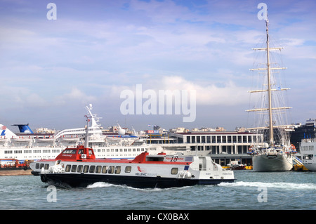 The varied sea traffic (a Hellenic Seaways Flying Dolphin, a roll on roll off ferry and a tourist cruiser tall ship) - Stock Photo