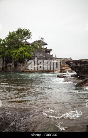 View onto the Temple Pura Tanah Lot - Stock Photo
