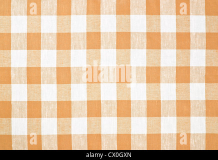 Brown or yellow checked tablecloth - Stock Photo