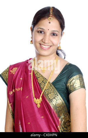 Portrait of young Indian traditional woman against white - Stock Photo