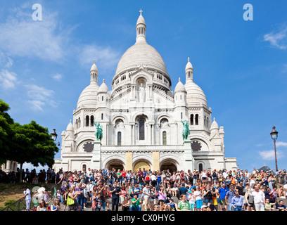 Crowds of tourists around the Sacre Coeur Paris France EU Europe - Stock Photo