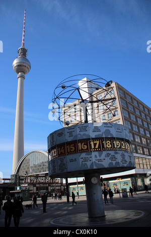 The clock in the world made by Eric John with behind the TV tower at Alexanderplatz, Berlin, Germany - Stock Photo