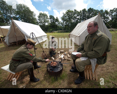 A scene from an historical enactment society's recreation of The First World War in the countryside of East Sussex. - Stock Photo